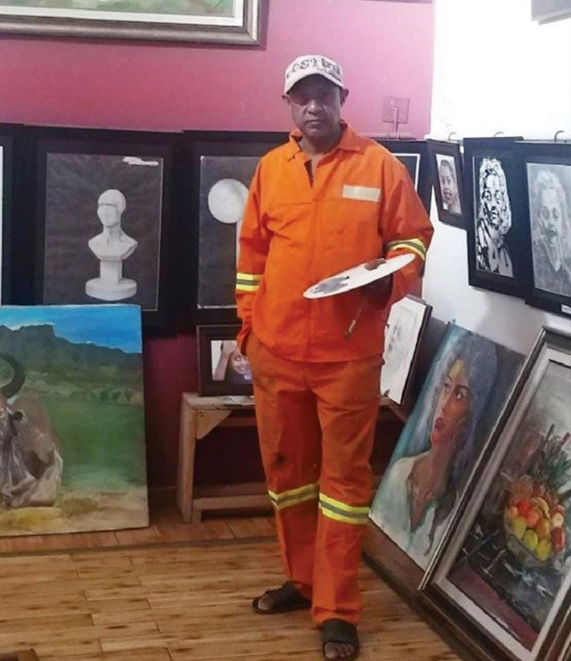 Dr. Ataklitie in his painting studio
